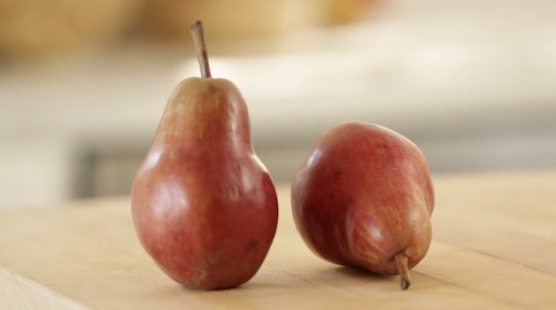 Red Pears on a cutting board
