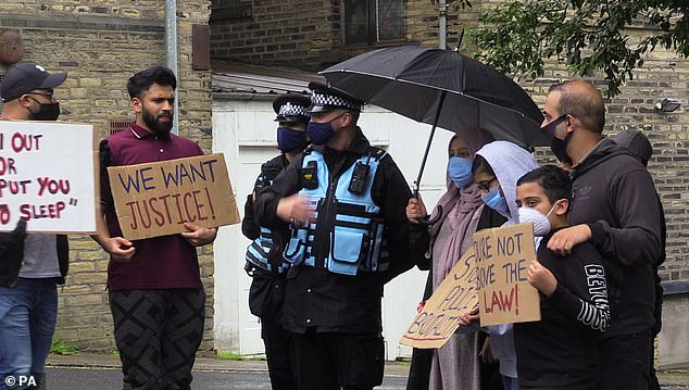 Police officers were surrounded by protesters carrying a number of placards as part of a demonstration in Halifax