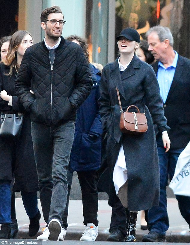 Walking in a winter wonderland: The Oscar-winning actress wrapped up against the winter chill in a charcoal grey FRAME coat, teamed with a white shirt dress and black PVC shoe boots