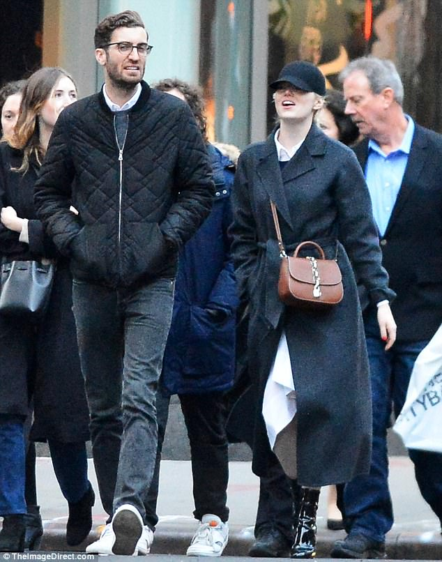Loved-up: Emma Stone and boyfriend, SNL writer  Dave McCary, made a rare outing in New York as they enjoyed a showing of The Nutcracker at the David H. Koch Theater on Tuesday